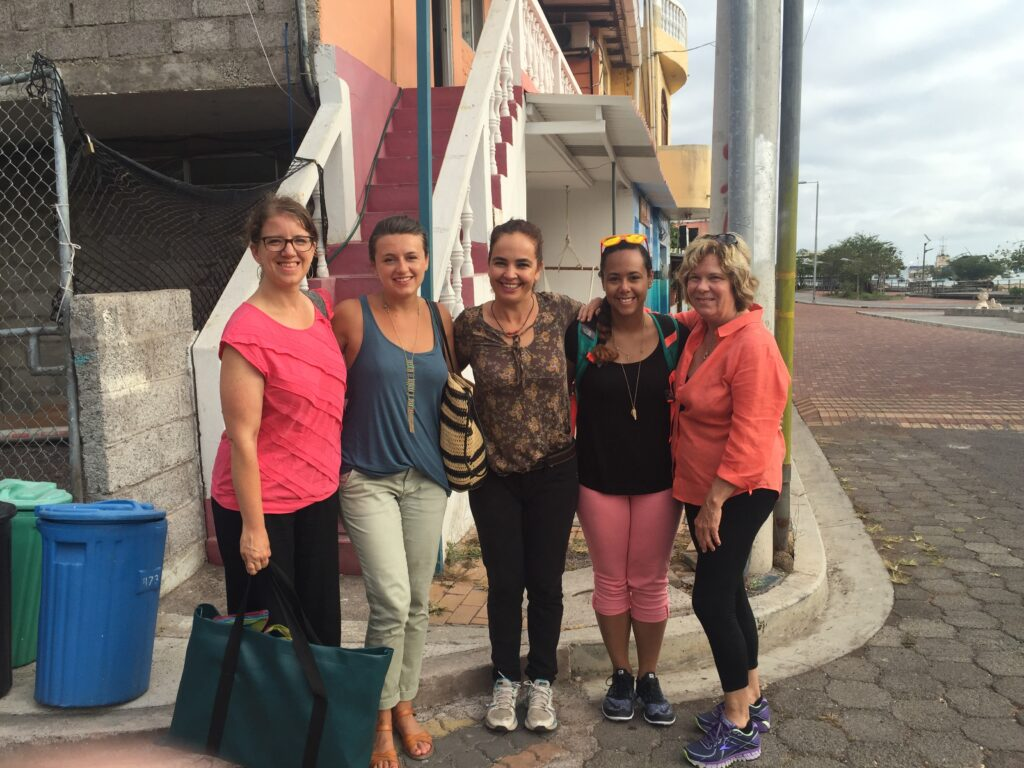 Photo: Five women pose in front of a staircase