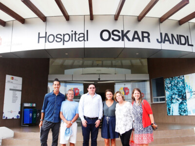 Photo: Six people pose for a photo in front of the Hospital Oskar Jandl